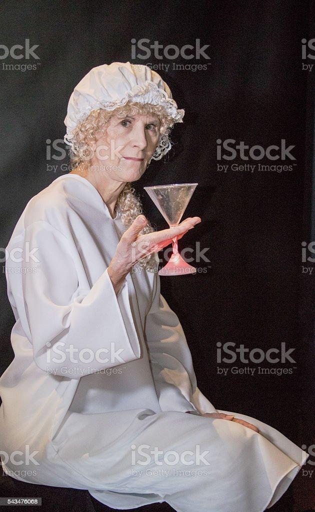 Senior Female Holding Her Alcoholic Drink Before Bedtime - Photo