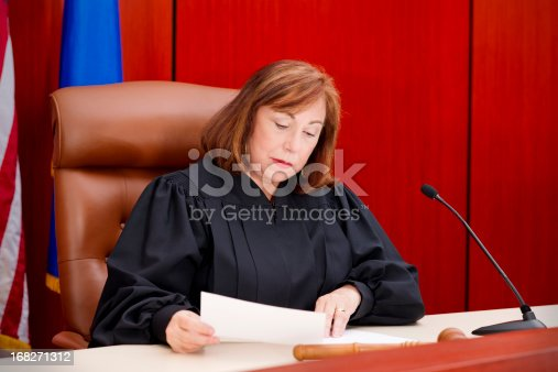 Senior female judge at the bench reading papers.  You might also be interested in this:
