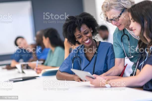Senior female lecturer assists medical students during class picture id1167849809?b=1&k=6&m=1167849809&s=612x612&h=ztu4yyv4s9ifh ukkk1q xodukavbufdytxn3qukyue=