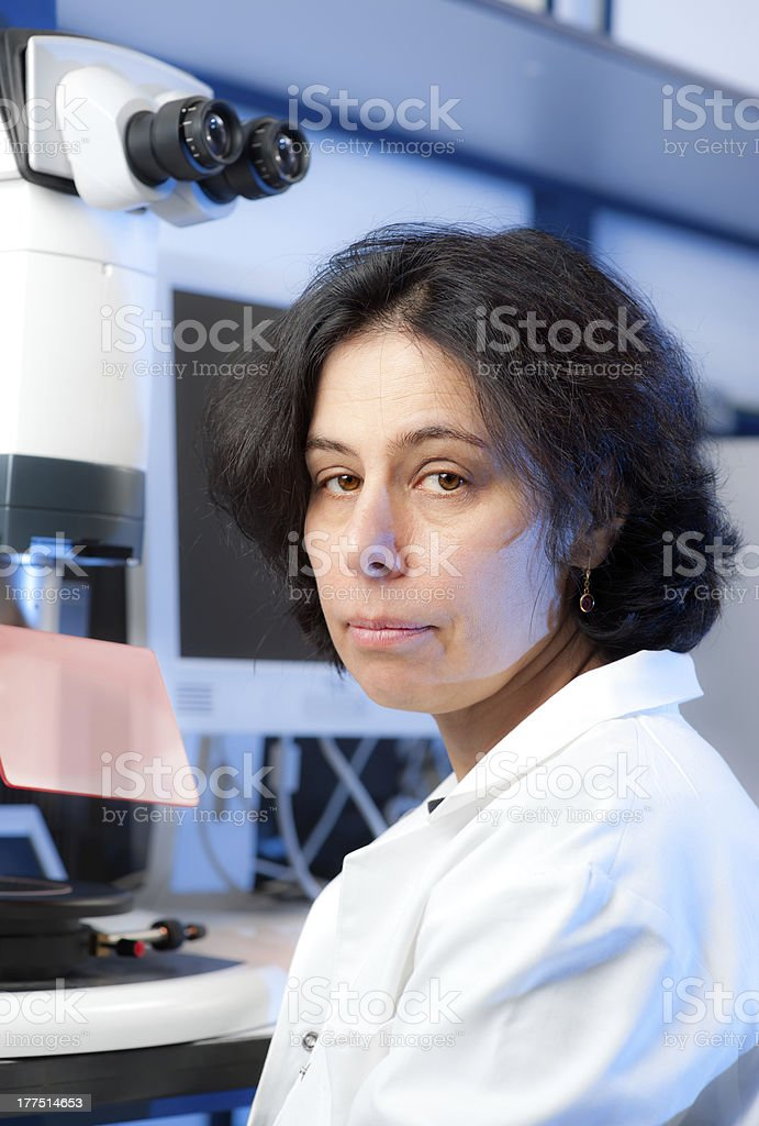 Senior female microscopist royalty-free stock photo