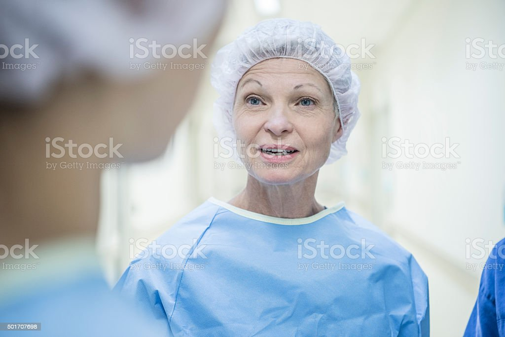 Candid portrait of female doctor in medical clothing. Female surgeon...