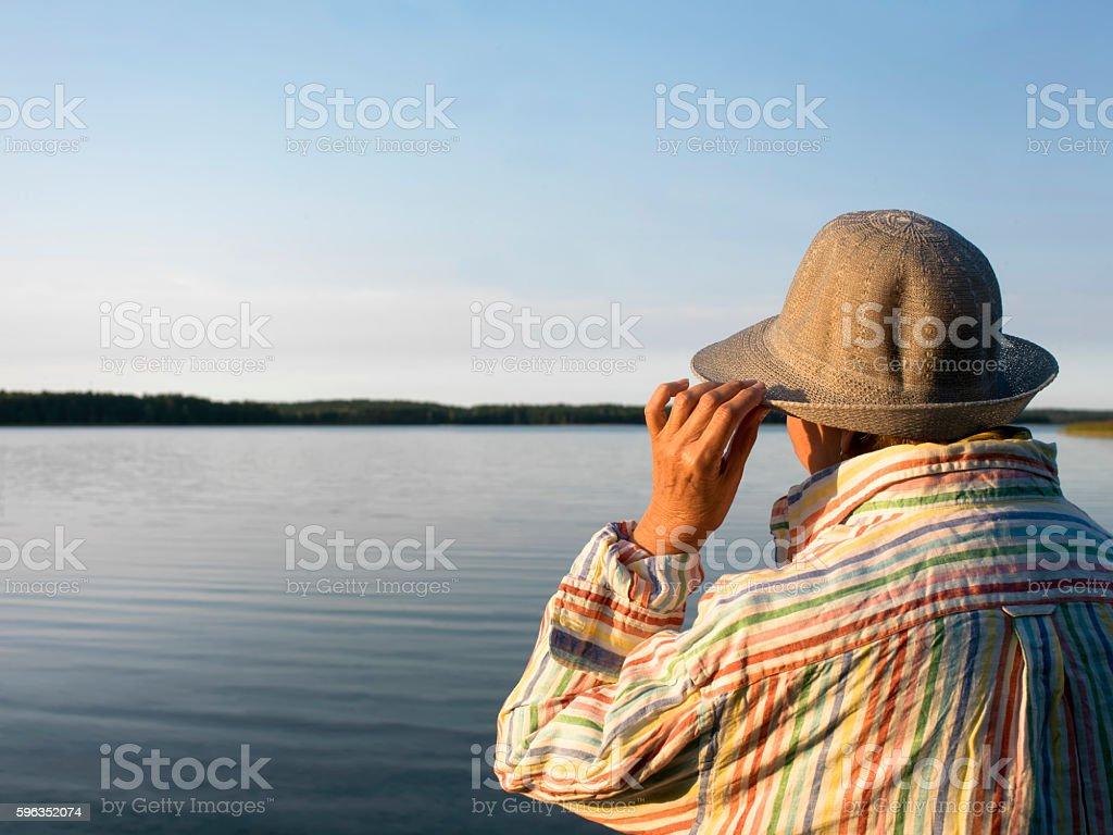 Senior Female On A Lake Lizenzfreies stock-foto