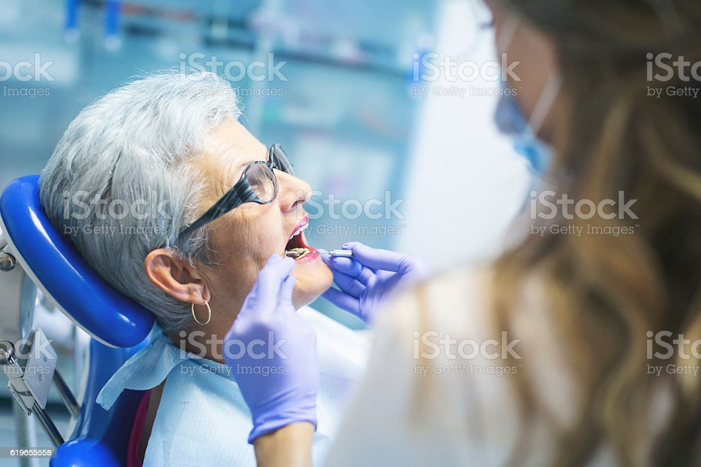 Senior female patient at dentist stock photo
