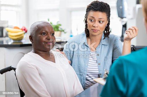 932074776 istock photo Senior female patient talks with home healthcare nurse 950886764