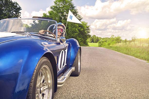 senior female racer with flag - alten muscle cars stock-fotos und bilder