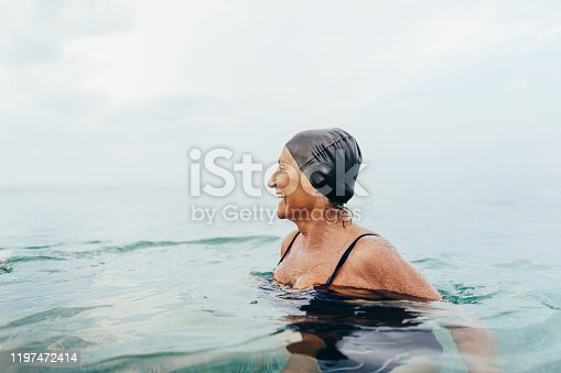 Photo of a senior female swimmer in the sea