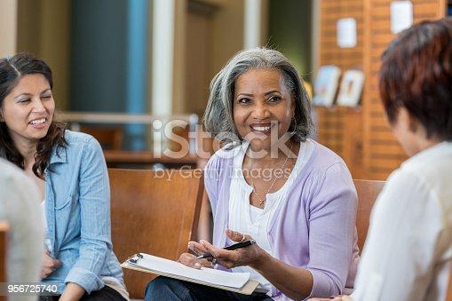 956725740istockphoto Senior female university professor teaches in casual setting 956725740