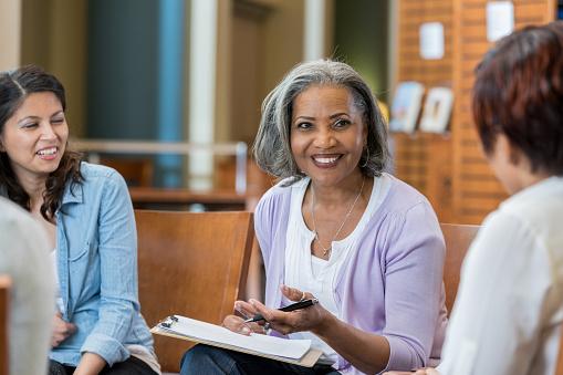istock Senior female university professor teaches in casual setting 956725740