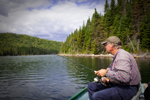 115874504 istock photo Senior Fisherman Catching a Fish 157649062