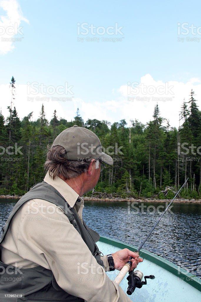 Senior Fisherman on Lake in Summer royalty-free stock photo