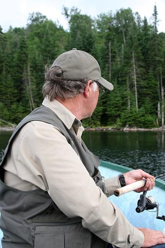 115874504 istock photo Senior Fisherman on Lake in Summer 172980719