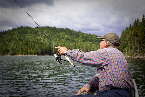 115874504 istock photo Senior Fisherman on Lake in Summer 182868200