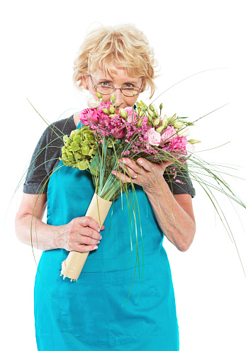 Senior Florist With Flowers On White Background Stock Photo - Download Image Now
