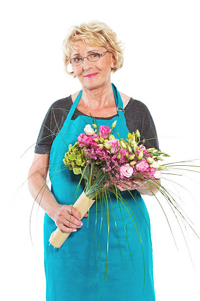 Senior florist with flowers on white background picture id519912943?b=1&k=6&m=519912943&s=612x612&w=0&h=cg8y39cklsmvghgbmlep4juopsjpob7tyydlsiqm4ay=