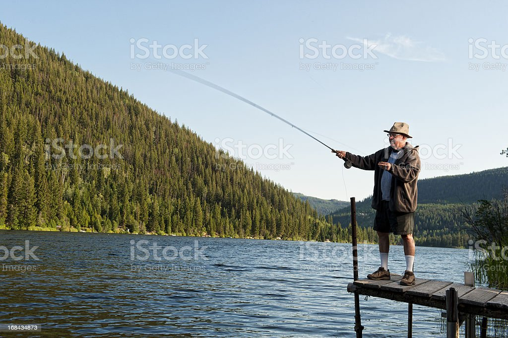 Senior Fly Fisherman In Action royalty-free stock photo