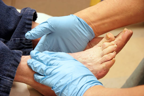 senior foot exam - podiatry stock pictures, royalty-free photos & images