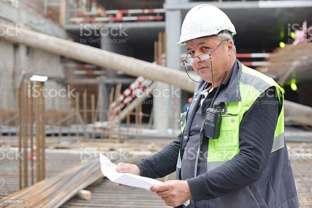 Senior Foreman At Construction Site stock photo
