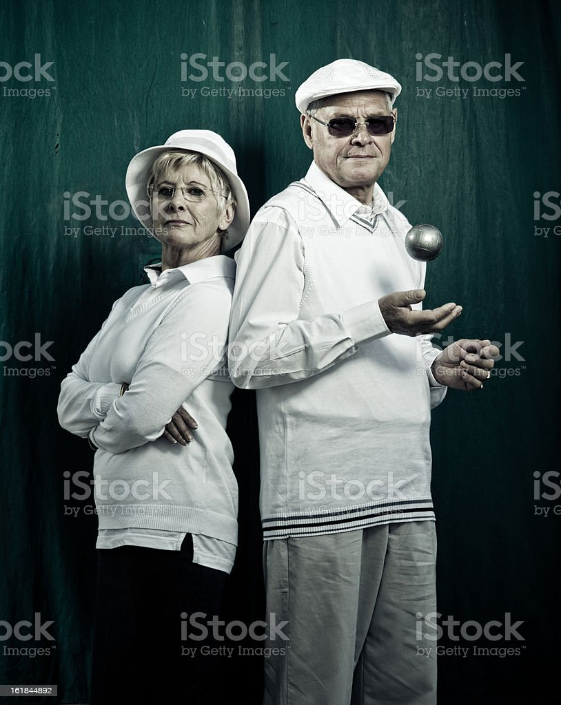 senior french couple of petanque players stock photo