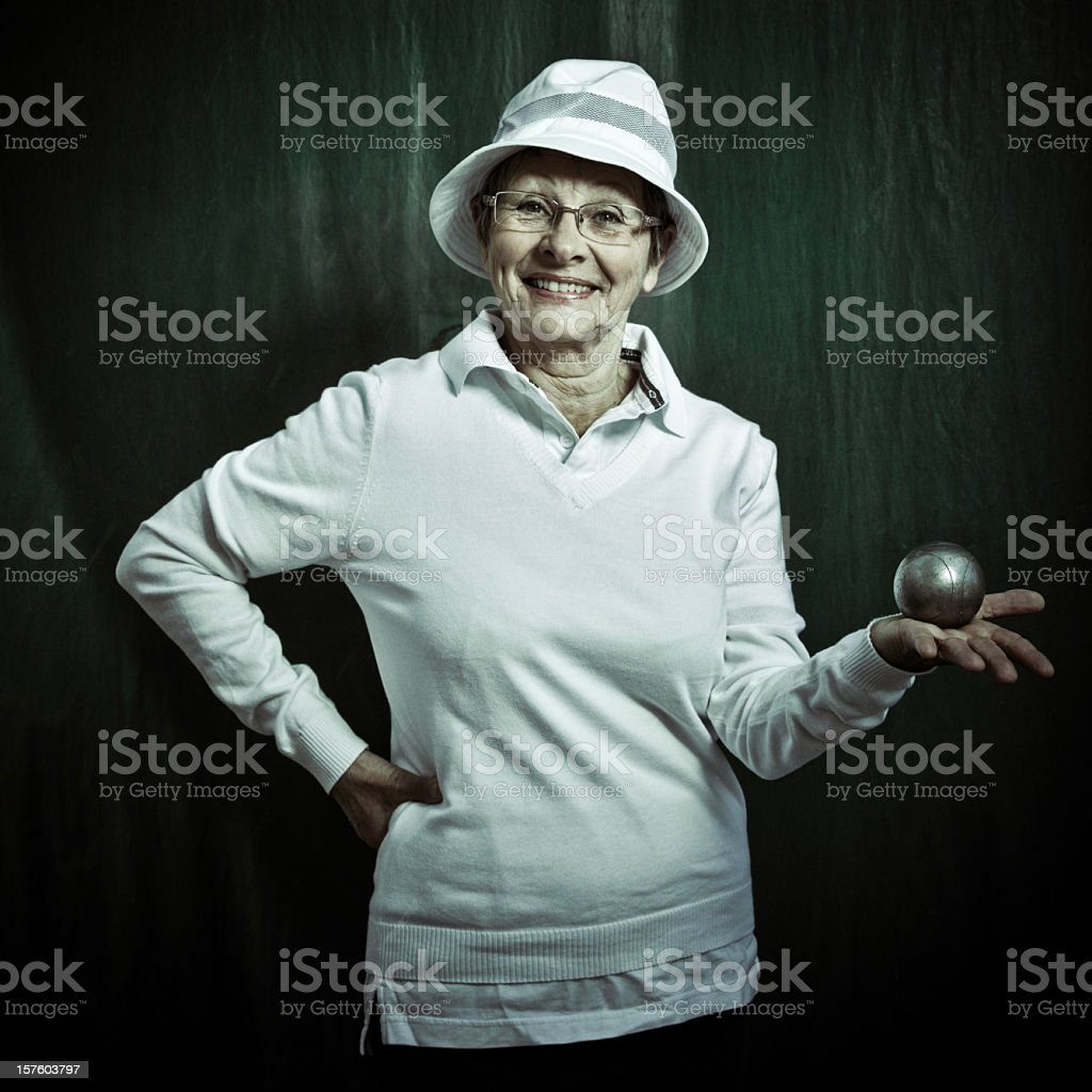 senior french petanque player woman stock photo