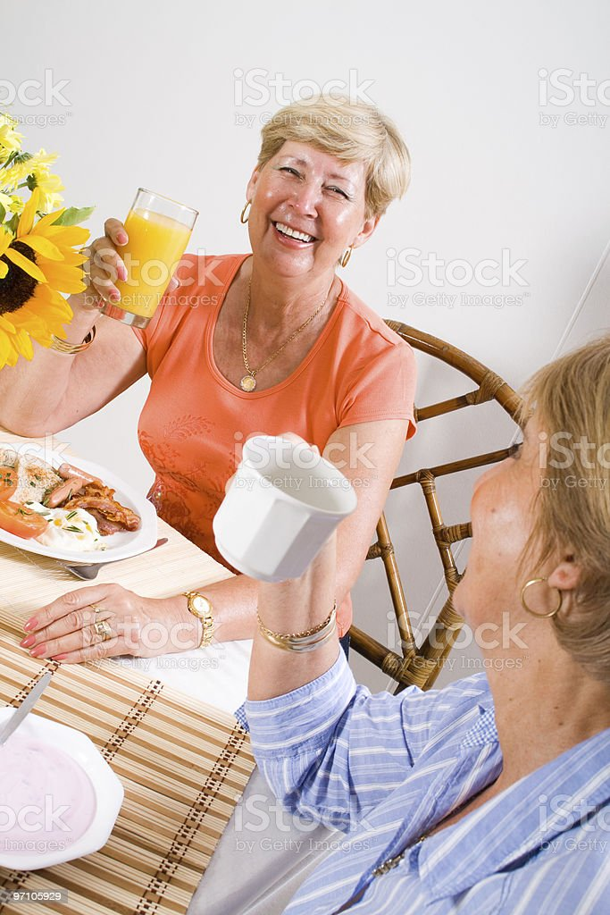 senior friends breakfast royalty-free stock photo