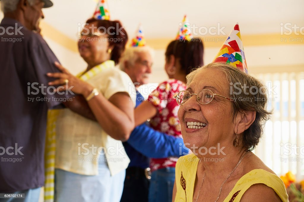 Senior Friends Dancing At Birthday Party In Hospice stock photo