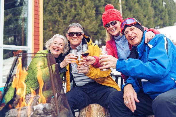 Senior Friends during a ski day stock photo