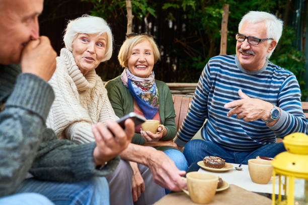 senior friends enjoying time outdoors - idosos imagens e fotografias de stock