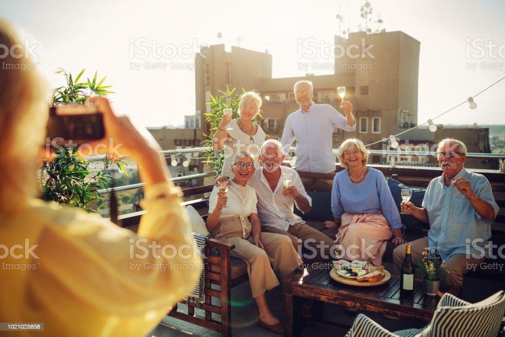 Senior Friends Having Fun On Rooftop stock photo