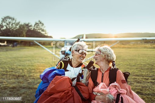 Close up of two senior friends after a successful skydive