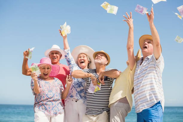 senior friends throwing money - throw money away stock pictures, royalty-free photos & images