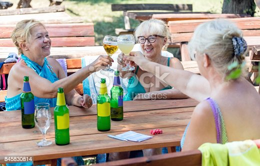 istock Senior friends toasting with beer 845830814