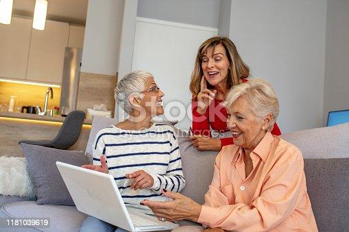 1053414472istockphoto Senior friends using a laptop. 1181039619