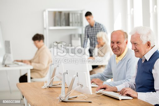 istock Senior friends working on computers 836502388
