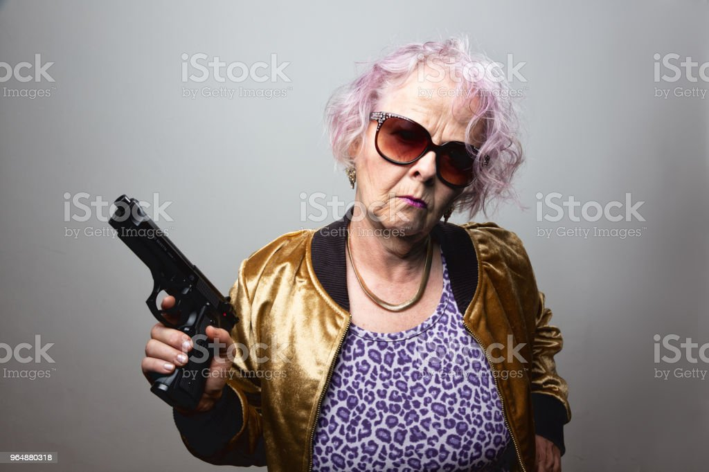 senior gangster lady holding gun royalty-free stock photo