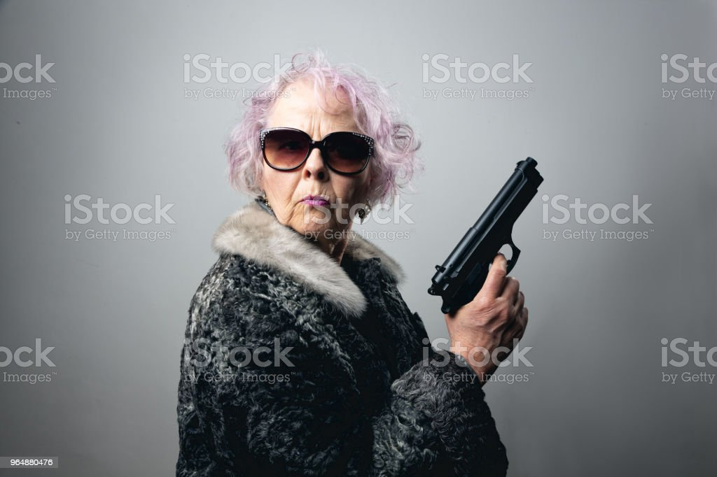 senior gangster lady holding gun royalty-free stock photo
