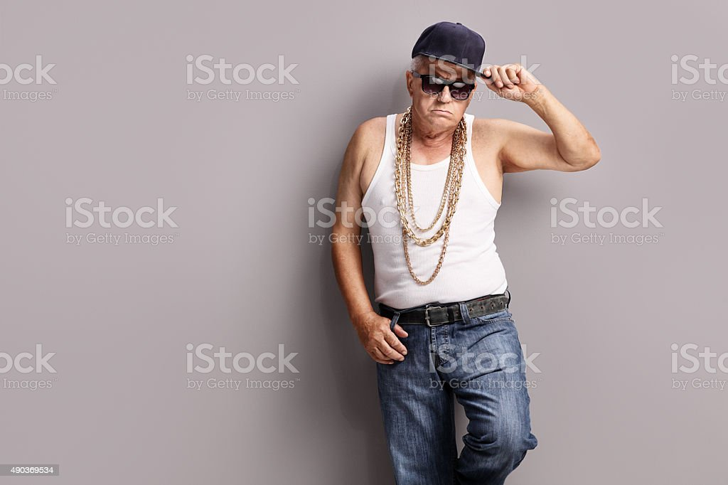 Senior gangster wearing hip-hop clothes stock photo