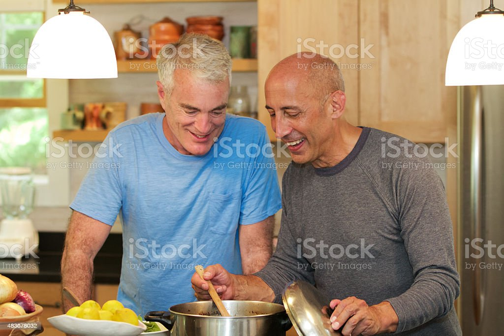 Senior Gay Male Couple Cooking Together stock photo