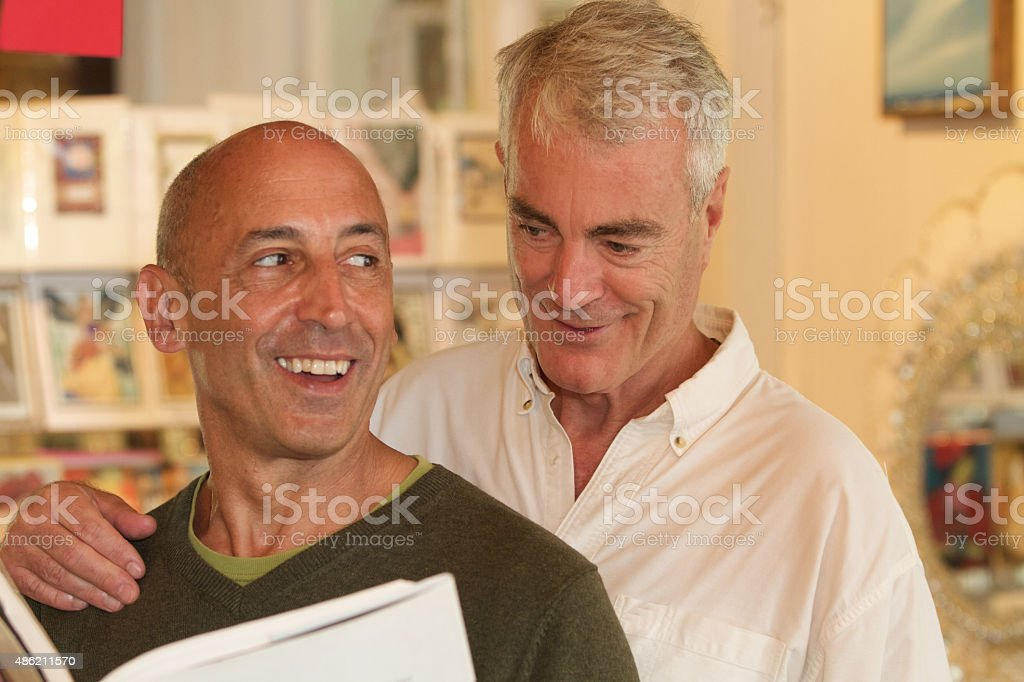 Senior Gay Male Couple Shopping in Home Accessories Store stock photo