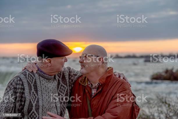 Photo of Senior gay married couple visiting Niagara Falls.
