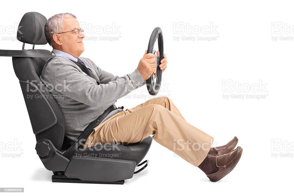 Senior gentleman driving stock photo