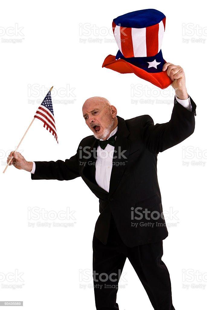 Senior gentleman wearing a Tux waving American Flag stock photo