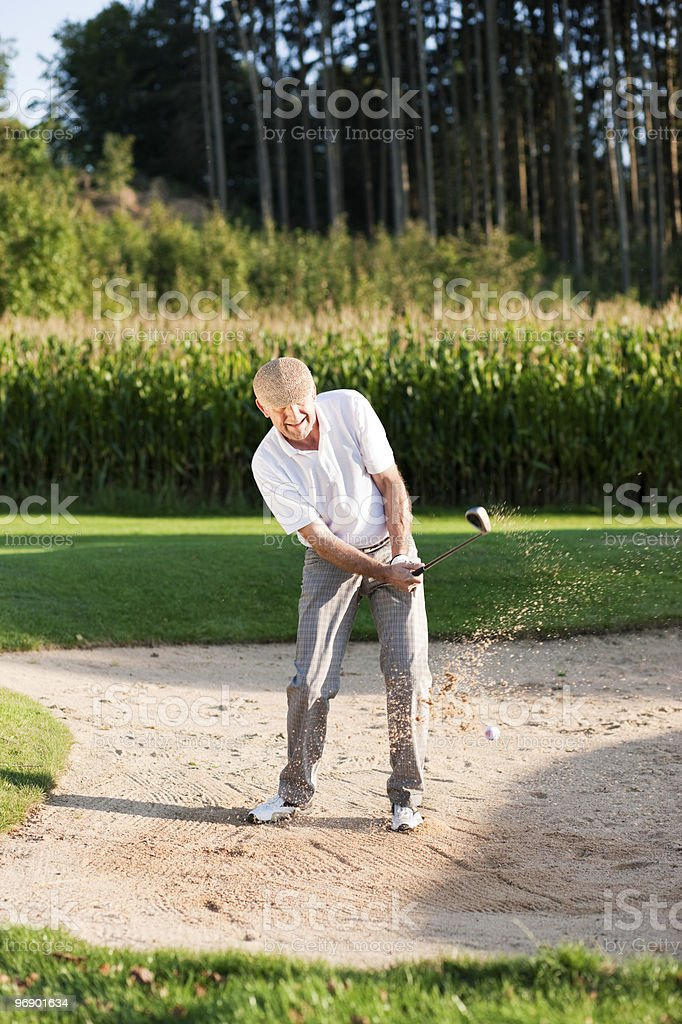 Senior golf player in sand trap royalty-free stock photo