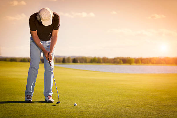 Senior golf player on green with copyspace. stock photo