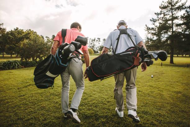 senior golfer after a game of golf - golf foto e immagini stock
