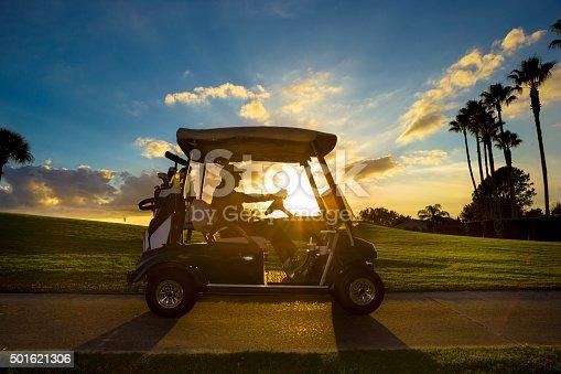 istock Senior golfer driving golf cart 501621306