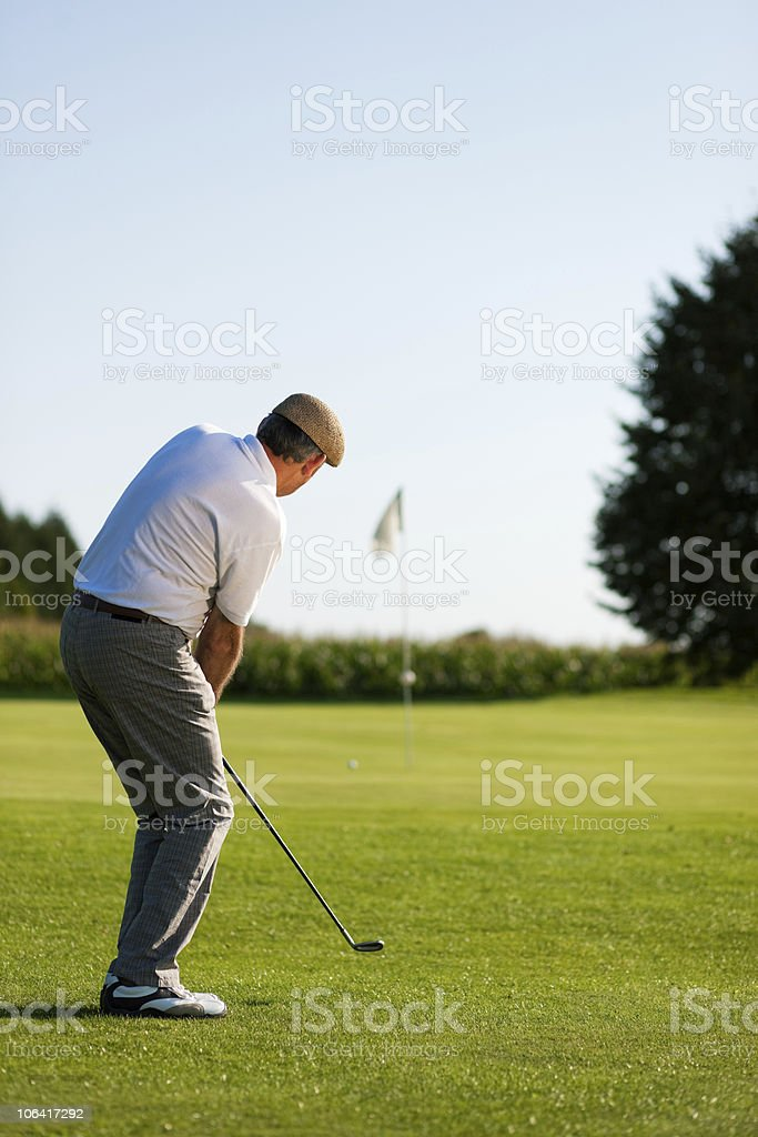 Senior golfer playing on a sunny summer day royalty-free stock photo