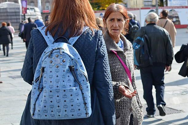 Senior gyspy woman begging stock photo