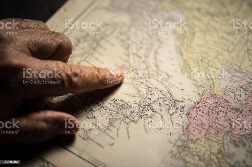 Senior hand and map