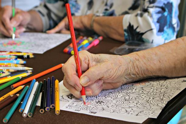 Senior hand coloring stock photo