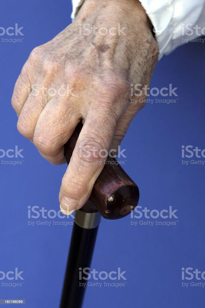 senior hand on cane (02) stock photo